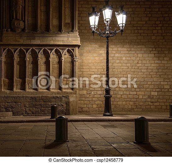 Beautiful streetlight in front of old building in Barcelona - csp12458779
