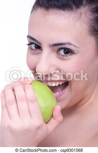 beautiful young brunette woman with a green apple - csp9301568