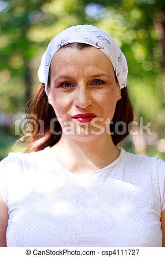 Beautiful young woman with a bandana smiling - csp4111727