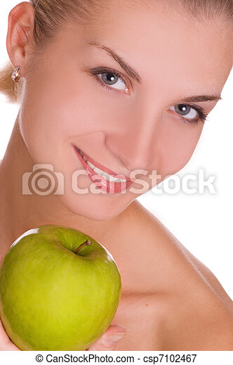 Beautiful young woman with green apple - csp7102467
