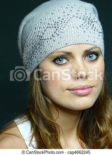 blue-eyed woman in a grey cap with pastes - csp4662245