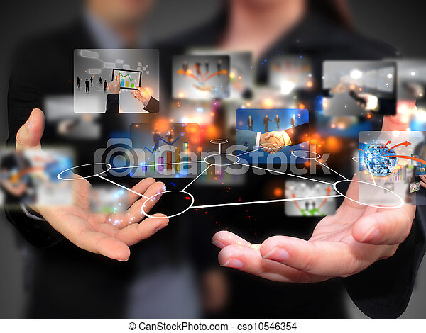 Business people holding social media - csp10546354