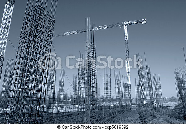 Construction site with enforced concrete steel frames rising up - csp5619592