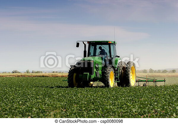 farmer plowing the field - csp0080098