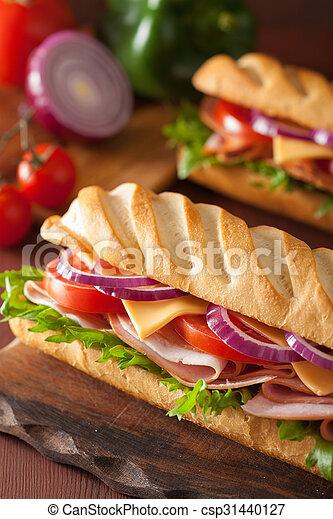 long baguette sandwich with ham cheese tomato lettuce - csp31440127