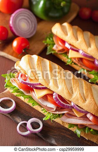 long baguette sandwich with ham cheese tomato lettuce - csp29959999