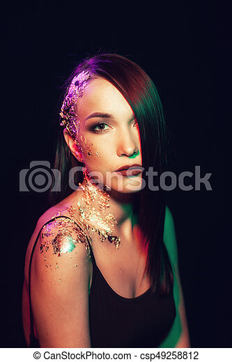 Portrait of a woman on a black background - csp49258812