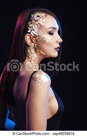 Portrait of a woman on a black background - csp49258816