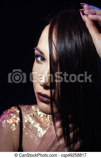 Portrait of a woman on a black background - csp49258817
