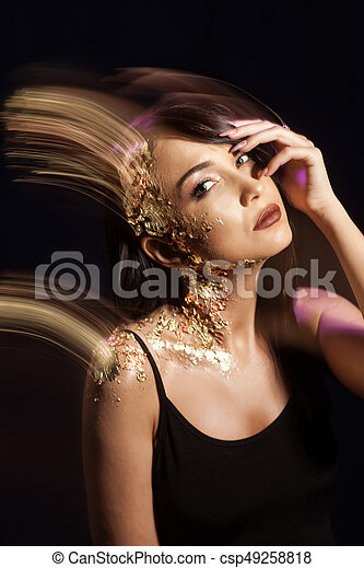 Portrait of a woman on a black background - csp49258818