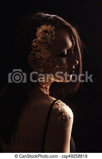 Portrait of a woman on a black background - csp49258819