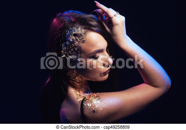 Portrait of a woman on a black background - csp49258809
