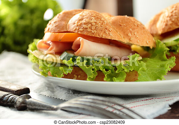 Sandwich with fresh lettuce, tomato, ham and cheese - csp23082409