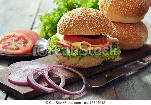 Sandwich with ham, cheese, tomato and lettuce - csp16894912