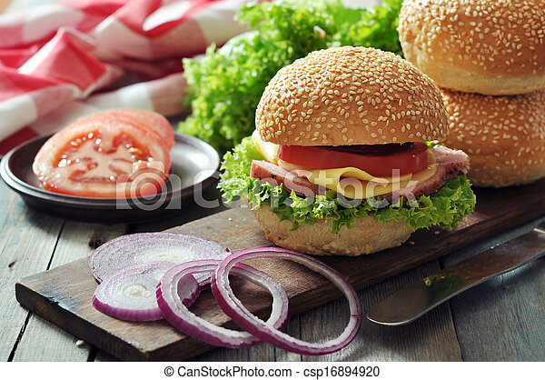 Sandwich with ham, cheese, tomato and lettuce - csp16894920