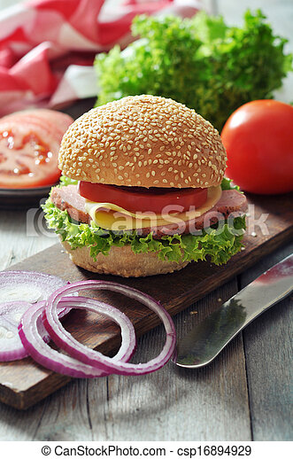 Sandwich with ham, cheese, tomato and lettuce - csp16894929