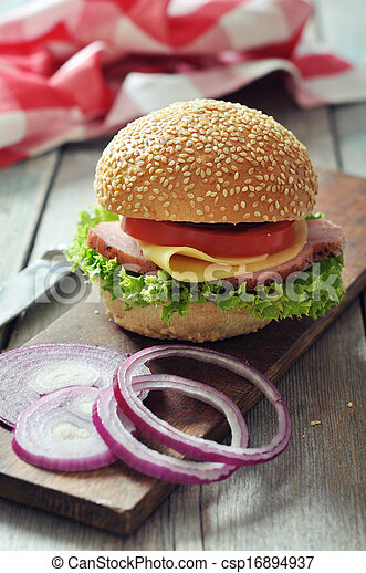 Sandwich with ham, cheese, tomato and lettuce - csp16894937