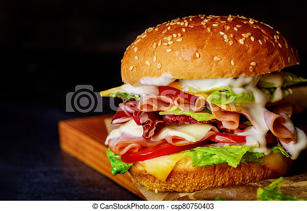 Sandwich with ham, lettuce, cheese and tomato. - csp80750403