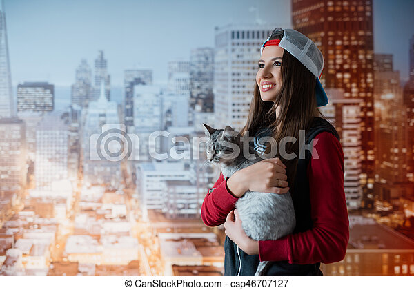 Smiling woman with a cat in hands - csp46707127