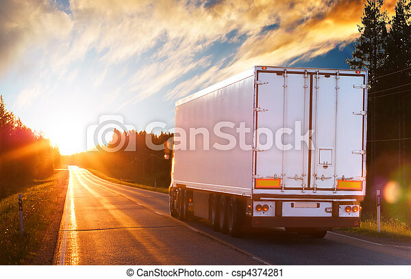 Truck on the asphalt road in the evening - csp4374281