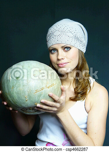 very beautiful young blue-eyed woman with a pumpkin in hands - csp4662287