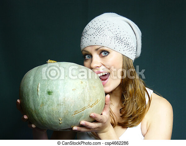 woman with a pumpkin in hands - csp4662286