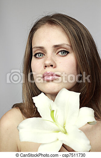woman with a snow-white lily in hands - csp7511730