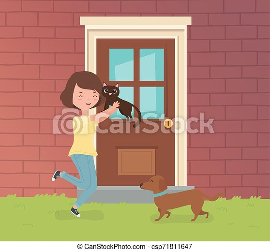 woman with cute little cat and dog in the house garden - csp71811647