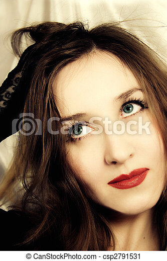 young blue-eyed woman with handbag in hand - csp2791531
