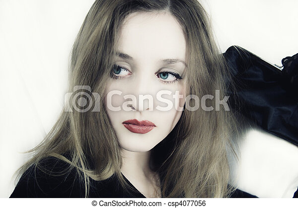 young blue-eyed woman with handbag in hand - csp4077056