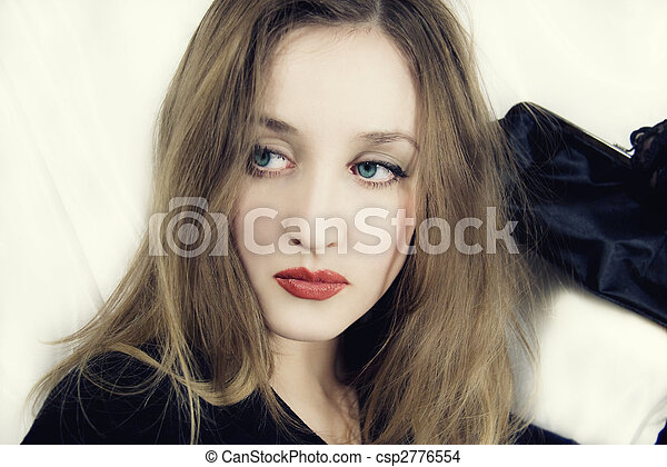 young blue-eyed woman with handbag in hand - csp2776554