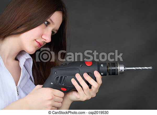 Young girl with drill in hands - csp2019530
