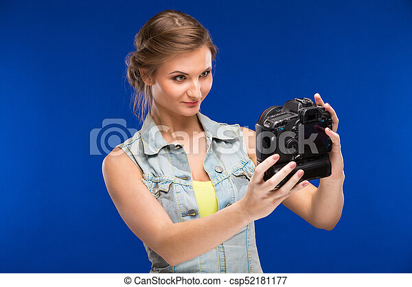 young woman with camera in hand - csp52181177