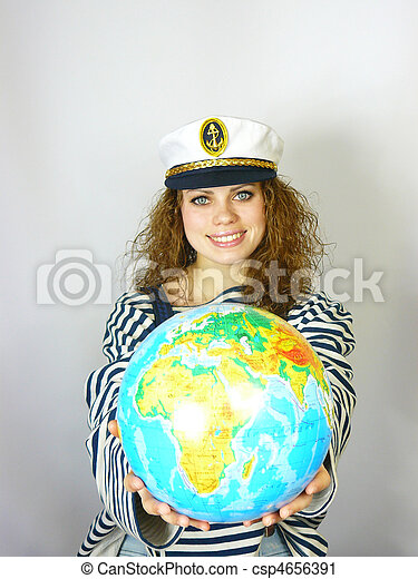 young woman with the globe in hands - csp4656391