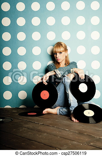 Young woman with vinyl records in the hands - csp27506119